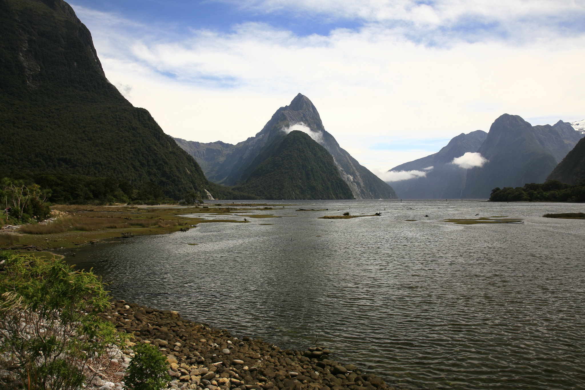 Overland Travel through the South Island of New Zealand will bring you to the shores of the most beautiful body of water you have ever seen - Milford Sound ...  photo by CC user vendin on Flickr